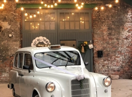 Classic London taxi for Manchester weddings